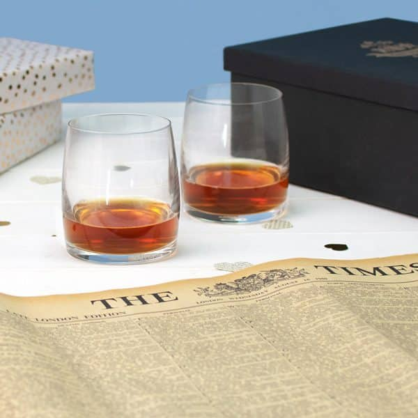 newspaper and whisky glasses set